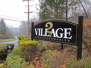 New Village II sign near Sugan Road (Photo: Charlie Sahner)