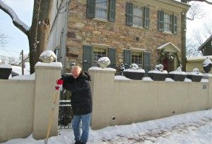 Jerry Deluca of New Street taking a break from shoveling snow Friday morning (Photo: Charlie Sahner)