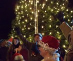 Mayor Larry Keller (center) Dee Fell (right) and George Fernandez (far right) as the tree is finally lit