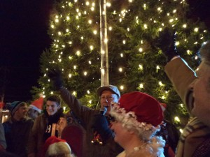 Mayor Larry Keller (center) Dee Fell (right) and George Fernandez (far right) as the tree is finally lit