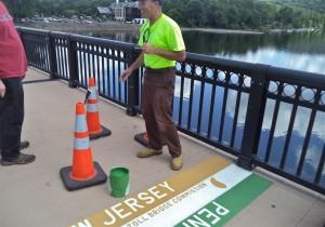 Photo of NJ/PA border being painted onto free bridge last summer