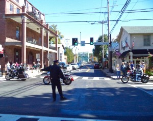 New Hope Police Corporal Zimmerman waves riders through intersection of Main and Bridge streets
