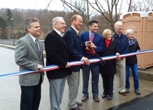 Bridge Bris: Officials from Bucks County and New Hope pose for the cameras as a porta potty watches on.