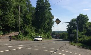 Because NJ-179 is a state road, putting in a sidewalk from Connaught Hill is difficult